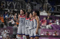 United States' Stefanie Dolson (13), Jacquelyn Young (8), Kelsey Plum (5) and Allisha Gray celebrate after defeating Russian Olympic Committee in a women's 3-on-3 gold medal basketball game at the 2020 Summer Olympics, Wednesday, July 28, 2021, in Tokyo, Japan. (AP Photo/Jeff Roberson)