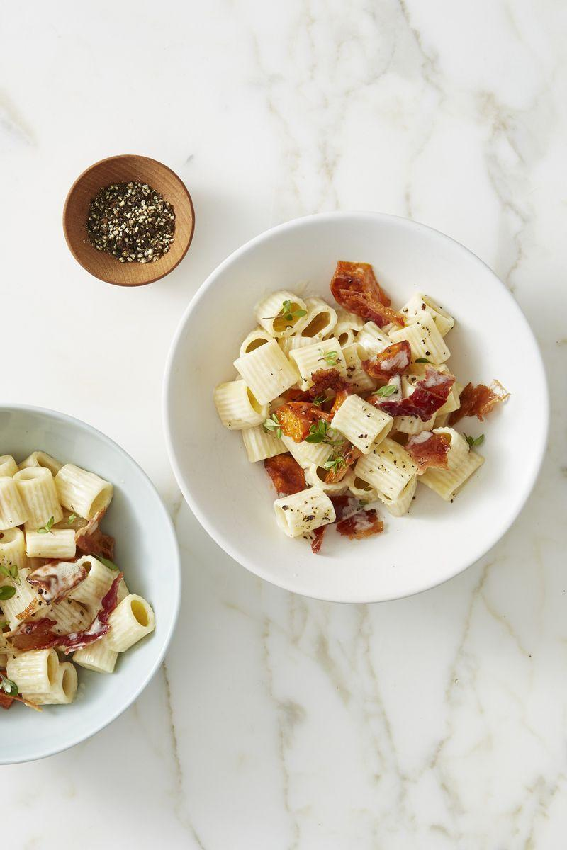 """<p>Savory bacon and sticky sweet potatoes come together as a creamy duo in this uber satisfying macaroni and cheese recipe. </p><p><em><a href=""""https://www.goodhousekeeping.com/food-recipes/easy/a45685/shortcut-mac-n-cheese-bacon-sweet-potatoes-recipe/"""" rel=""""nofollow noopener"""" target=""""_blank"""" data-ylk=""""slk:Get the recipe for Shortcut Mac 'n' Cheese with Crispy Bacon and Sweet Potatoes »"""" class=""""link rapid-noclick-resp"""">Get the recipe for Shortcut Mac 'n' Cheese with Crispy Bacon and Sweet Potatoes »</a></em></p>"""