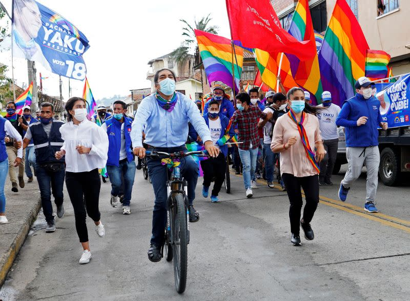 FILE PHOTO: Ecuadorean presidential candidate Yaku Perez rides his bike during his closing campaign rally ahead of the February 7 presidential vote, in Cuenca
