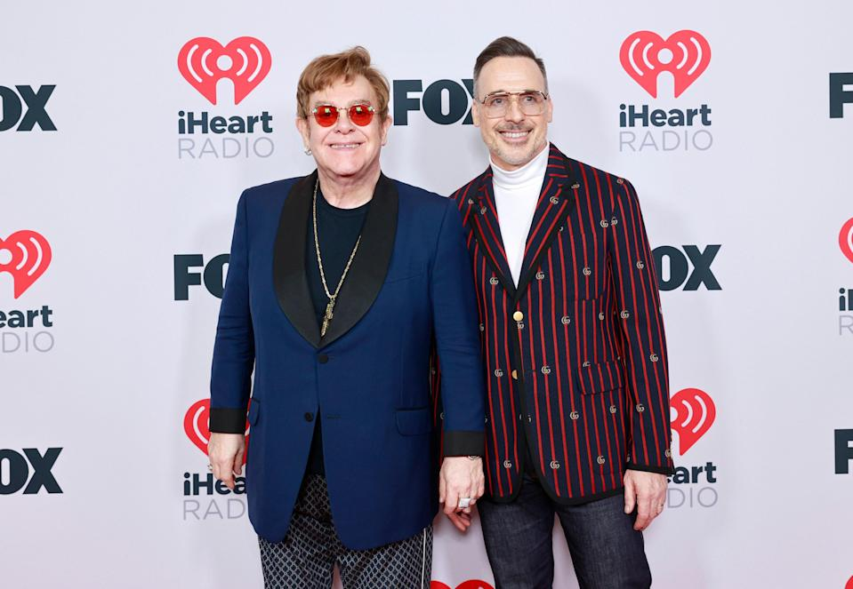 And speaking of Elton John, the honoree and husband David Furnish looked wholesome as ever on the red carpet. Elton rocked a navy blazer and his signature tinted shades and David wore a striped blazer and retro aviators.