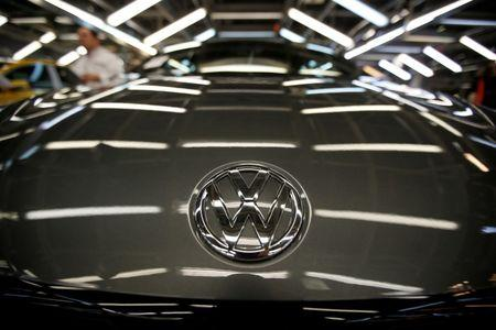 FILE PHOTO: The logo of Volkswagen company is seen on a car on an assembly line at the Volkswagen car factory in Palmela