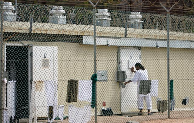 """GUANTANAMO BAY, CUBA - OCTOBER 2: (IMAGE REVIEWED BY U.S. MILITARY PRIOR TO TRANSMISSION) A detainee moves from one room to another inside Camp 1 at the detention facility at the U.S. Naval Station October 2, 2007 in Guantanamo Bay, Cuba. About 340 """"unlawful enemy combatants"""" captured since the September 11, 2001 attacks on the United States continue to be held at the facility. (Photo by Chip Somodevilla/Getty Images)"""