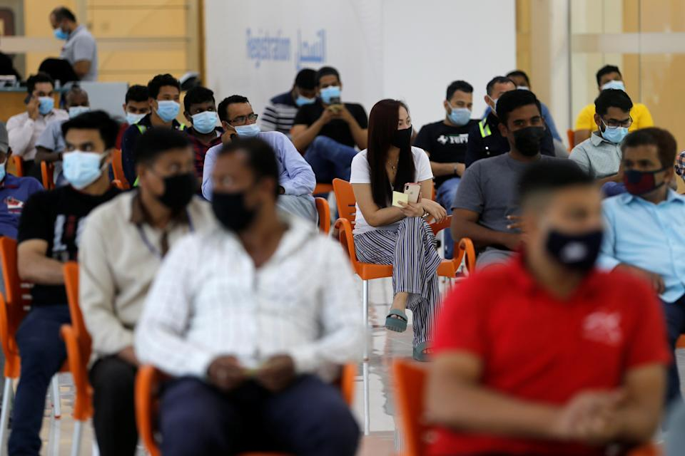 People wait in Sitra Mall to get vaccination against the coronavirus disease (COVID-19), in Sitra, Bahrain, March 23, 2021. Picture taken March 23, 2021. REUTERS/Hamad I Mohammed