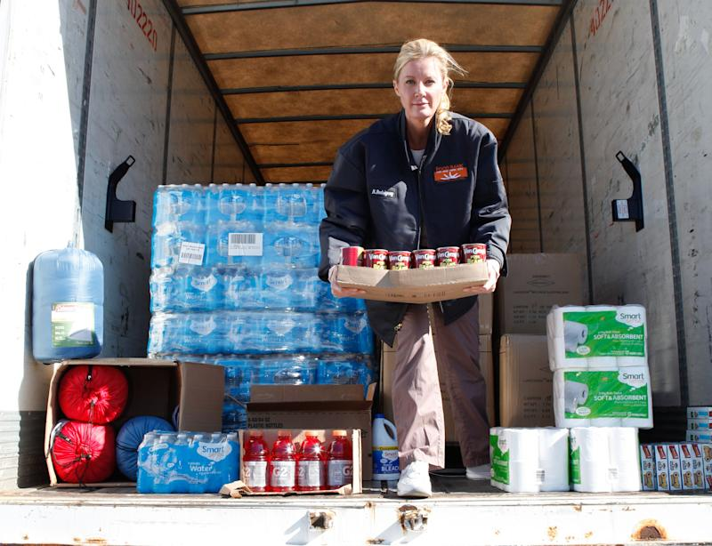 This Nov. 4, 2012 photo released by Sears-KMart shows Food network personality Sandra Lee unloading donated items for storm victims to a food bank warehouse in the Bronx borough of New York.  Lee is pleading a simple message about Superstorm Sandy recovery efforts _ Don't get complacent. Though government efforts to help those caught in the path of last week's epic storm have been tremendous, as have contributions by corporations and individual donors, Lee fears a fallout from all the goodwill and good deeds _ people outside the worst-hit areas might assume the work is finished. Lee has been working the phones to arrange corporate donations for New York's food banks and other charities, including five truckloads of food and emergency supplies from Kmart and Sears. (AP Photo/Sears/KMart, Jill Lotenberg)