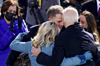 U.S. Vice President Kamala Harris applauds as President Joe Biden is embraced by his son Hunter, first lady Jill Biden and daughter Ashley, during the 59th presidential inauguration in Washington, Wednesday, Jan. 20, 2021. (Kevin Dietsch/Pool Photo via AP)