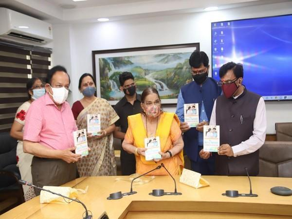 Union Health Minister Dr Harsh Vardhan (pink shirt) unveiling Dr Krishna Saksena's (in yellow) book