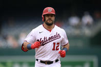Washington Nationals' Kyle Schwarber rounds the bases after hitting a home run in first inning of the first baseball game of a doubleheader against the San Francisco Giants, Saturday, June 12, 2021, in Washington. This game is a makeup of a postponed game from Thursday. (AP Photo/Nick Wass)
