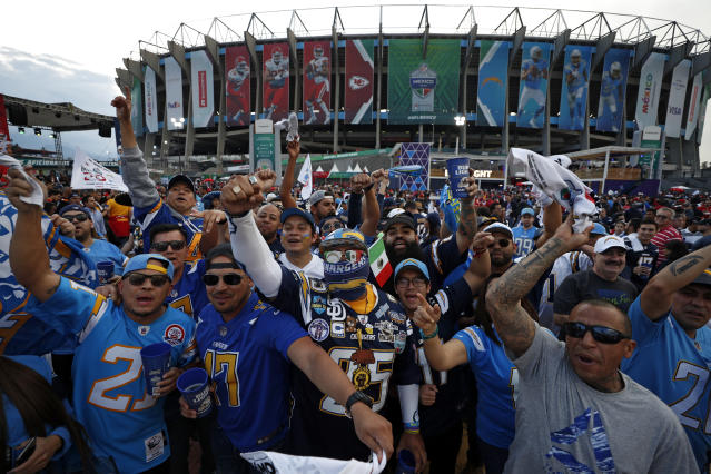 Fans cheer before an NFL football game between the Los Angeles Chargers and the Kansas City Chiefs Monday, Nov. 18, 2019, in Mexico City. (AP Photo/Rebecca Blackwell)