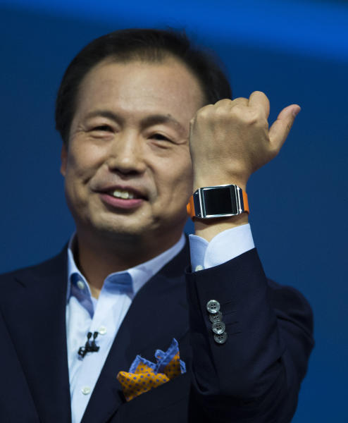 JK Shin, head of Samsung Mobile Communications, presents the Samsung Galaxy Gear in Berlin, Germany, Wednesday, Sept. 4, 2013. Samsung has unveiled a highly anticipated digital wristwatch well ahead of a similar product expected from rival Apple. The so-called smartwatch is what some technology analysts believe could become this year's must-have holiday gift. Samsung unveiled the Galaxy Gear on Wednesday in Berlin ahead of the annual IFA consumer electronics show. (AP Photo/Gero Breloer)
