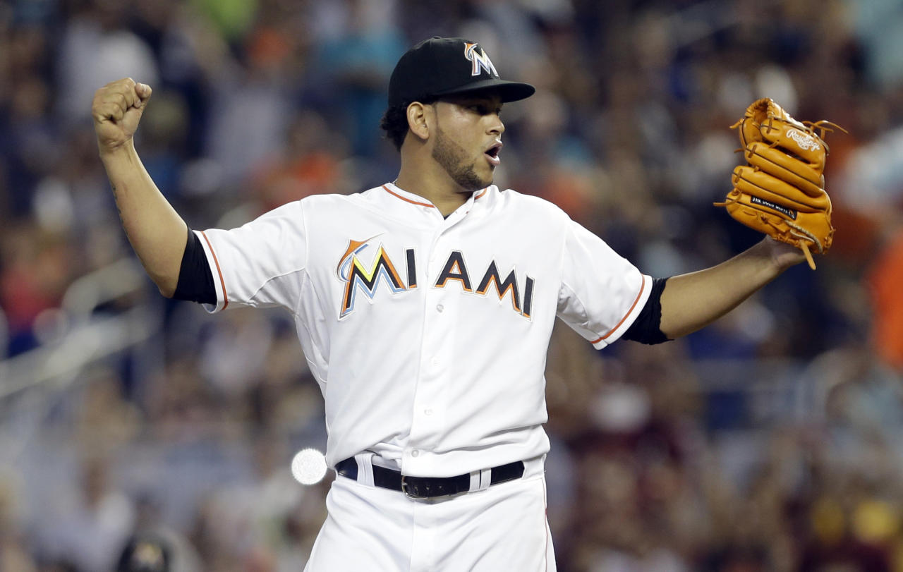 Miami Marlins' Henderson Alvarez celebrates after striking out Detroit Tigers' Matt Tuiasosopo for the last out of the ninth inning of an interleague  baseball game on Sunday, Sept. 29, 2013, in Miami. Alvarez got a no-hitter as the Marlins won 1-0. (AP Photo/Alan Diaz)