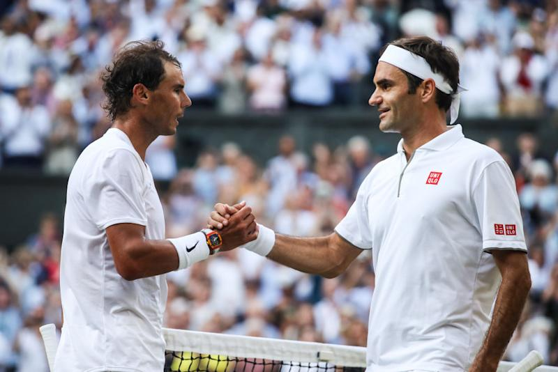 LONDON, ENGLAND - JULY 12: Roger Federer (R) of Switzerland shakes hands with Rafael Nadal of Spain after their Men's Singles semi-final match during Day eleven of The Championships - Wimbledon 2019 at All England Lawn Tennis and Croquet Club on July 12, 2019 in London, England. (Photo by Shi Tang/Getty Images)