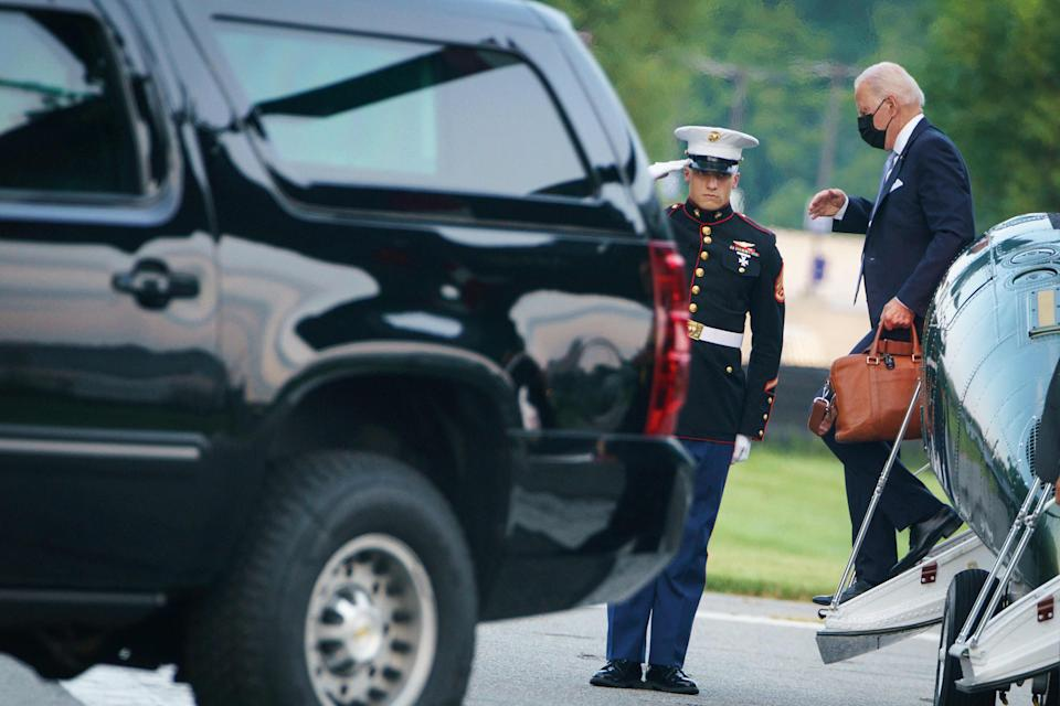 President Joe Biden steps off Marine One upon arrival at Walter Reed Medical Center in Bethesda, Maryland to visit First Lady Jill Biden on July 29, 2021.
