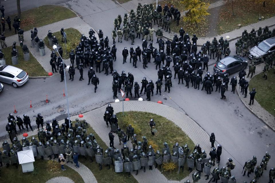 Belarusian riot police block the road to stop demonstrators during an opposition rally to protest the official presidential election results in Minsk, Belarus, Sunday, Nov. 15, 2020. A Belarusian human rights group says more than 500 people have been arrested in protests around the country calling for authoritarian President Alexander Lukashenko to step down. The Sunday demonstrations continued to wave of near-daily protests that have gripped Belarus since early August. (AP Photo)
