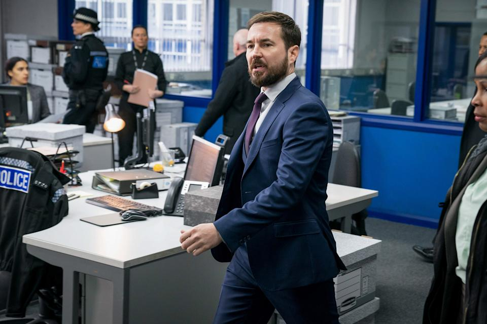 WARNING: Embargoed for publication until 00:00:01 on 23/03/2021 - Programme Name: Line of Duty S6 - TX: n/a - Episode: Line Of Duty - Ep 2 (No. n/a) - Picture Shows: *NOT FOR PUBLICATION UNTIL TUESDAY 23RD MARCH, 2021* Miscellaneous Crew, DS Steve Arnott (MARTIN COMPSTON) - (C) World Productions - Photographer: Steffan Hill