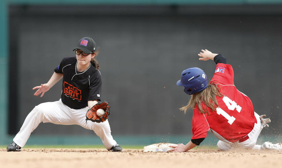 Maycen Gibbs (14), of Folsom, Calf., steals second base against Rebecca Priscilla Stern, of Cabin John, Md., during a baseball game in Arlington, Texas, Friday, March 8, 2019. More than 60 high school girls from the United States, as well as Canada and Puerto Rico are taking part in the inaugural MLB Grit event, a tournament specifically for girls who play baseball. (AP Photo/LM Otero)