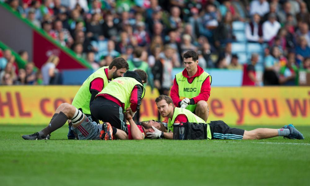 Chris Robshaw lies on the turf with a head injury and receives treatment.