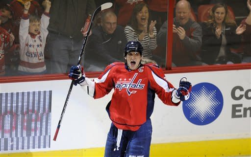Washington Capitals left wing Alex Ovechkin (8), of Russia, celebrates his goal during the second period of an NHL hockey game against the Montreal Canadiens, Friday, Feb. 24, 2012, in Washington. (AP Photo/Nick Wass)