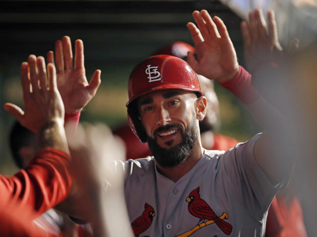 St. Louis Cardinals' Matt Carpenter is congratulated after hitting a home run during the seventh inning of the second baseball game of a doubleheader against the Chicago Cubs on Saturday, July 21, 2018, in Chicago. (AP Photo/Jim Young)