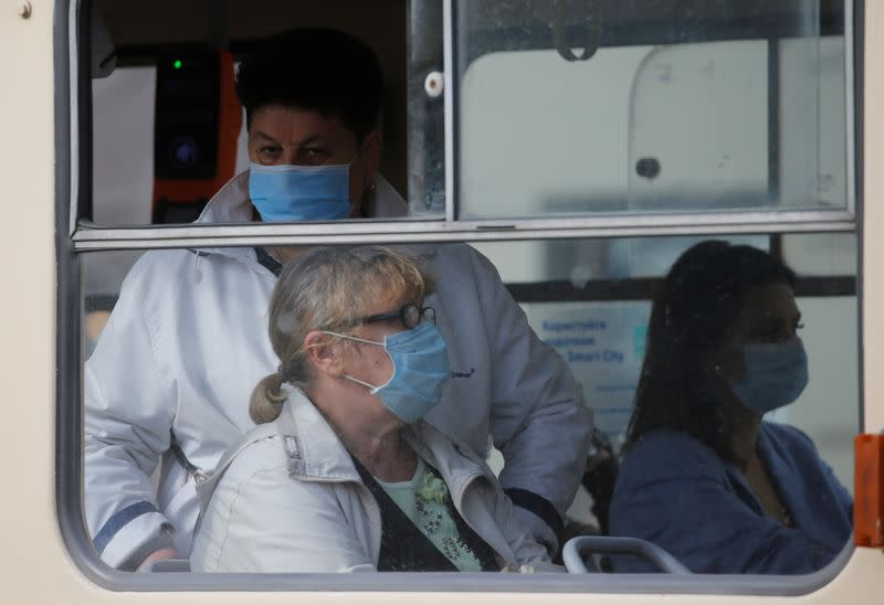 Passengers wearing protective face masks are seen inside a tram in Kyiv