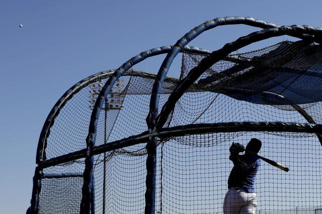 Kansas City Royals' Salvador Perez bats during spring training baseball practice Wednesday, Feb. 12, 2020, in Surprise, Ariz. (AP Photo/Charlie Riedel)