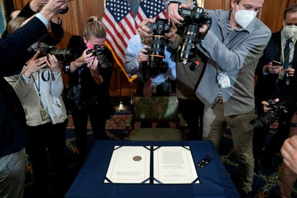 PHOTO: Photographers take pictures of the article of impeachment against President Donald Trump prior to it being signed at the U.S. Capitol on Jan. 13, 2021, in Washington, D.C. (Stefani Reynolds/Getty Images)