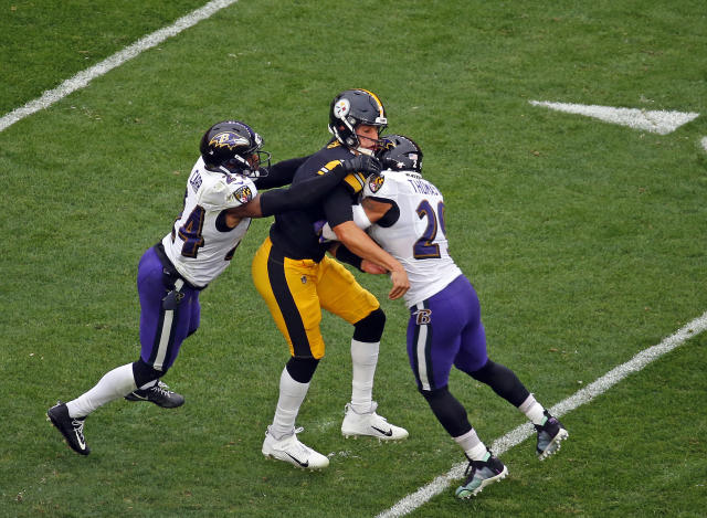 A scary moment as Steelers' QB Mason Rudolph was knocked out by this hit. The in-stadium medical cart was broken and Rudolph inexplicably was walked off the field. (Getty Images)