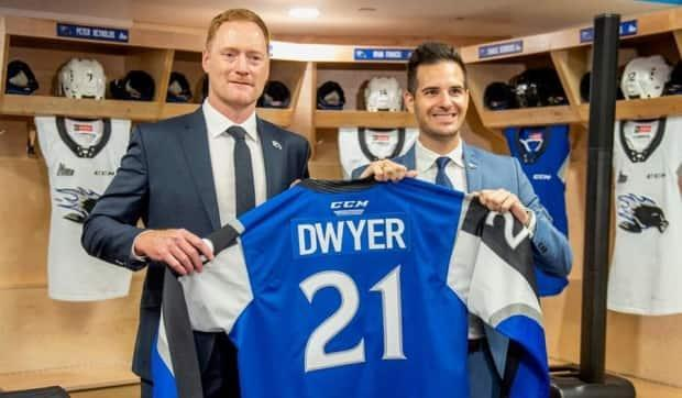 Gordie Dwyer, left, with Saint John Sea Dogs president Trevor Georgie at the news conference Wednesday introducing Dwyer as the team's new head coach. (Saint John Sea Dogs - image credit)