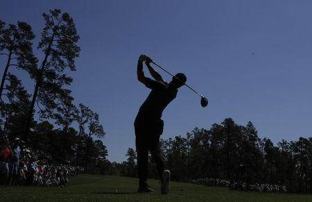 Rory McIlroy of Northern Ireland hits off the 14th tee during Tuesday practice rounds for the 2017 Masters at Augusta National Golf Club in Augusta, Georgia, U.S., April 4, 2017. REUTERS/Lucy Nicholson