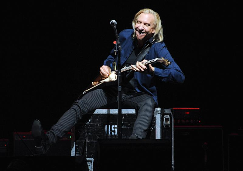 Musician Joe Walsh of the Eagles performs at Madison Square Garden on Friday, Nov. 8, 2013 in New York. (Photo by Evan Agostini/Invision/AP)