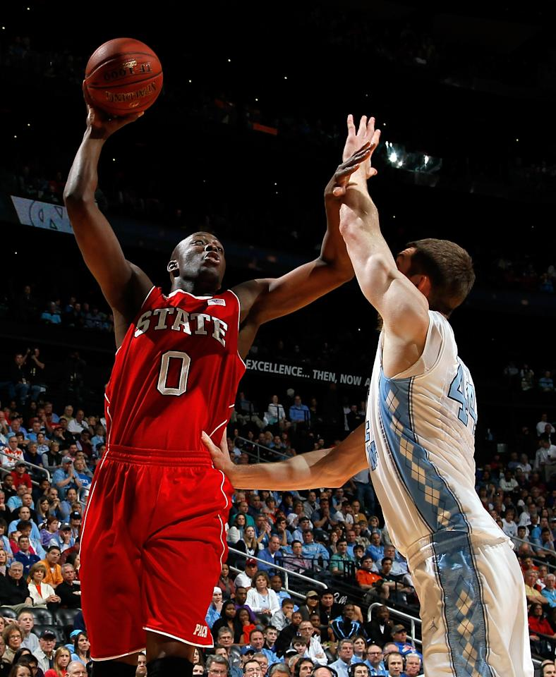ATLANTA, GA - MARCH 10:  DeShawn Painter #0 of the North Carolina State Wolfpack shoots against Tyler Zeller #44 of the North Carolina Tar Heels during the semifinals of the 2012 ACC Men's Basketball Conference Tournament at Philips Arena on March 10, 2012 in Atlanta, Georgia.  (Photo by Kevin C. Cox/Getty Images)