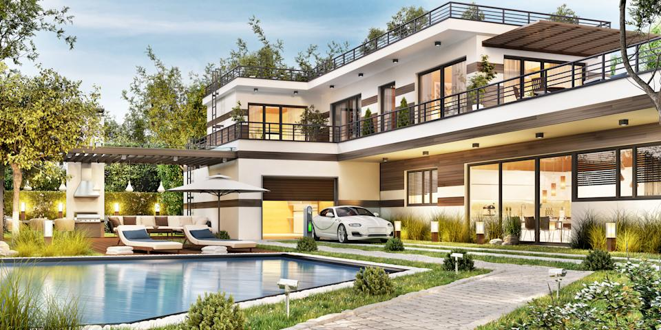 Modern house with a large beautiful terrace, barbecue, swimming pool, garage with electric car