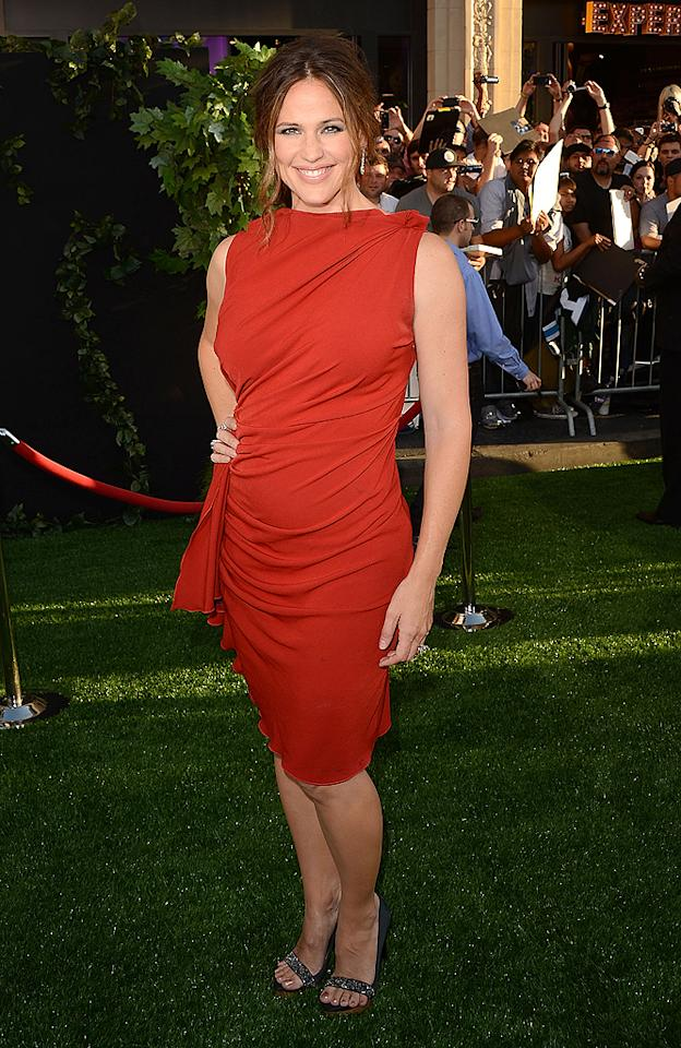 """Perhaps it's just us, but we think Jennifer Garner keeps getting better with age. Ben Affleck's better half appeared absolutely gorgeous upon arriving at the Los Angeles premiere of her new film, <a target=""""_blank"""" href=""""http://movies.yahoo.com/movie/the-odd-life-of-timothy-green/"""">""""The Odd Life of Timothy Green,""""</a> in a cheerful, tomato-colored dress, which featured dramatic draping and a high neckline. Va-va-voom! (8/6/2012)<br><br><a target=""""_blank"""" href=""""http://twitter.com/YahooOmg"""">Follow omg! on Twitter!</a>"""
