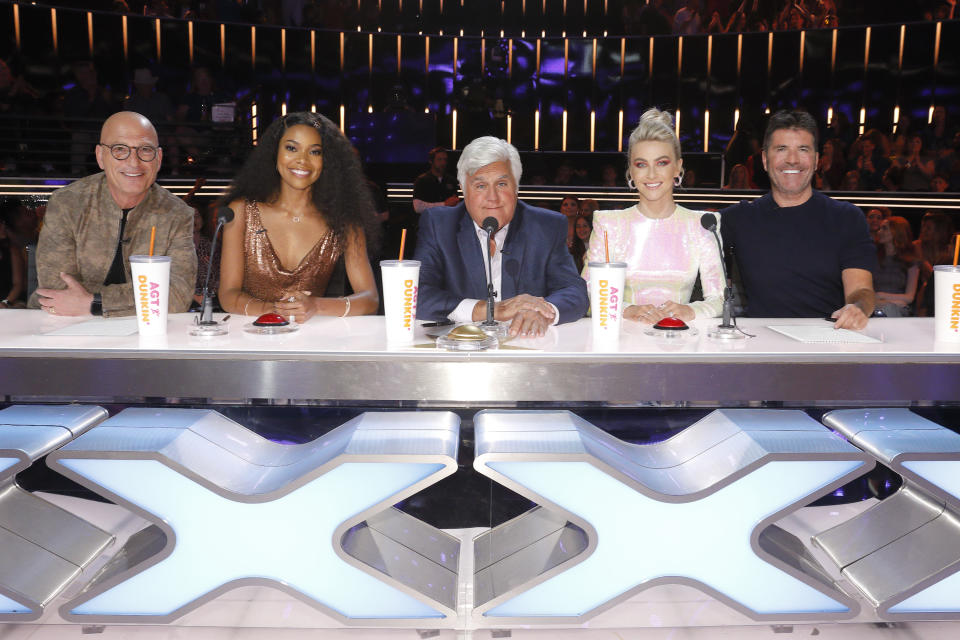 """AMERICA'S GOT TALENT -- """"Judge Cuts"""" -- Pictured: (l-r) Howie Mandel, Gabrielle Union, Jay Leno, Julianne Hough, Simon Cowell -- (Photo by: Trae Patton/NBCU Photo Bank/NBCUniversal via Getty Images via Getty Images)"""