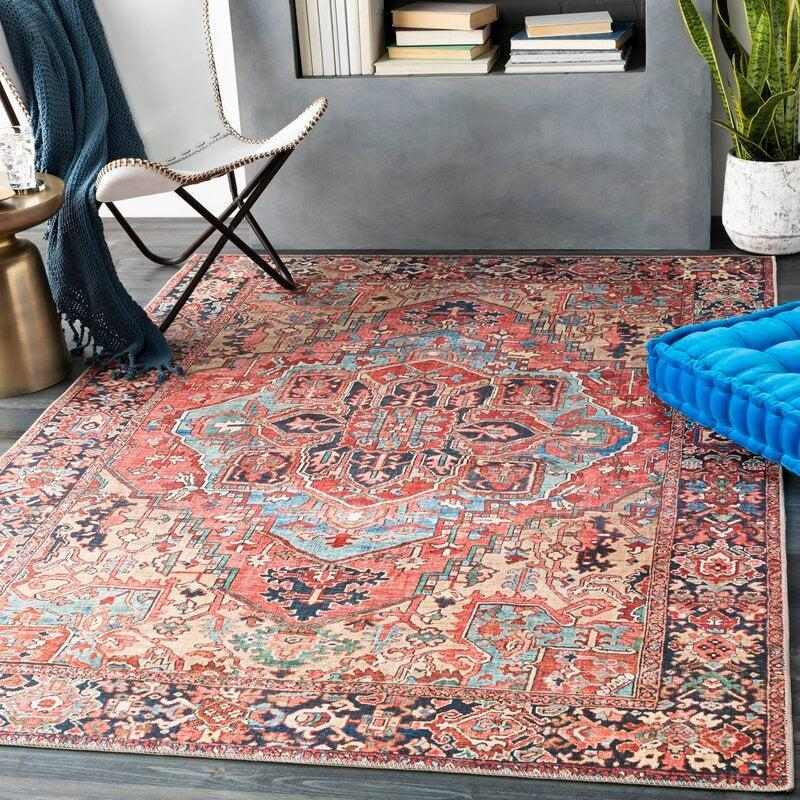 """<h3>Most Wanted Rugs</h3><br><h2>World Menagerie Crook Bright Area Rug</h2><br><strong>Deal: 63% off</strong><br>Last year, we declared this rug to be, """"WAY more richy-rich than it actually is,"""" and we're sticking to it. World Menagerie's area rug will brighten up a room with its vibrant colors and won't rob your wallet — it's a win-win. <br><br><em>Shop</em> <strong><em><a href=""""https://www.wayfair.com/brand/bnd/world-menagerie-b39354.html"""" rel=""""nofollow noopener"""" target=""""_blank"""" data-ylk=""""slk:World Menagerie"""" class=""""link rapid-noclick-resp"""">World Menagerie</a></em></strong><br><br><strong>World Menagerie</strong> Crook Area Rug, $, available at <a href=""""https://go.skimresources.com/?id=30283X879131&url=https%3A%2F%2Fwww.wayfair.com%2Frugs%2Fpdp%2Fworld-menagerie-crook-oriental-bright-redbeigeblue-area-rug-w001646412.html"""" rel=""""nofollow noopener"""" target=""""_blank"""" data-ylk=""""slk:Wayfair"""" class=""""link rapid-noclick-resp"""">Wayfair</a>"""