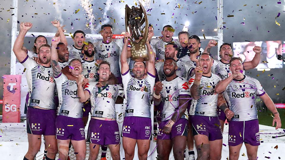 Pictured here, Melbourne Storm players hoist the 2020 NRL premiership trophy aloft.