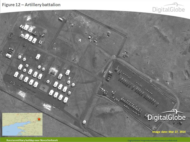 This satellite image made by DigitalGlobe on March 27, 2014, and provided by Supreme Headquarters Allied Powers Europe (SHAPE) on Tuesday, April 9, 2014, shows what is purported to be a Russian artillery battalion at a military base near Novocherkassk, east of the Sea of Azov in southern Russia. The image is one of several provided to the AP by NATO's headquarters that show dozens of Russian tanks and other armored vehicles, combat jets and helicopter gunships stationed inside Russian territory near to the eastern border with Ukraine. AP cannot independently verify the authenticity or content of this image. (AP Photo/DigitalGlobe via SHAPE) MANDATORY CREDIT, NO CROPPING OR MODIFICATIONS ALLOWED