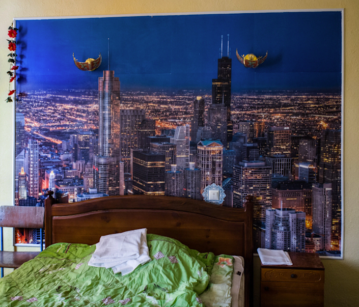 A light-feeling Ukrainian prion cell adorned with a large cityscape poster.