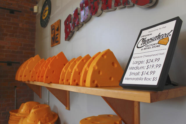 This Jan. 16, 2020 photo shows foam cheesehead hats at Foamation, Inc. in Milwaukee. Ralph Bruno invented the yellow wedge cheesehead in 1987 from his mother's couch stuffing and it has since become popular, particularly for Wisconsin sports fans and residents. His company, Foamation, Inc., moved into a new location in 2016 and soon started tours where people can make their own cheeseheads or other foam products. (AP Photo/Carrie Antlfinger)
