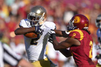 Notre Dame wide receiver Chris Brown, left, stiff-arms Southern California cornerback Adoree Jackson during the first half of an NCAA college football game, Saturday, Nov. 29, 2014, in Los Angeles. (AP Photo/Mark J. Terrill)