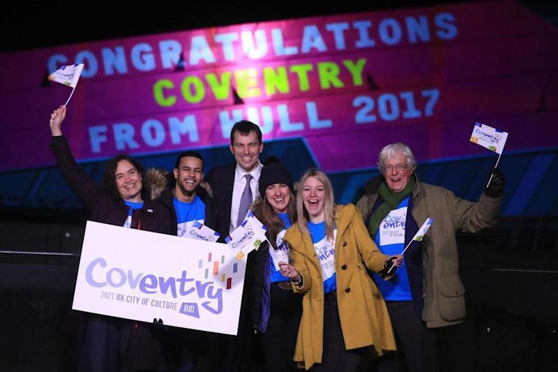 Celebrations: Arts Minister John Glen (3rd left) with people celebrating in Hull that Coventry will become the next UK City of Culture (PA)