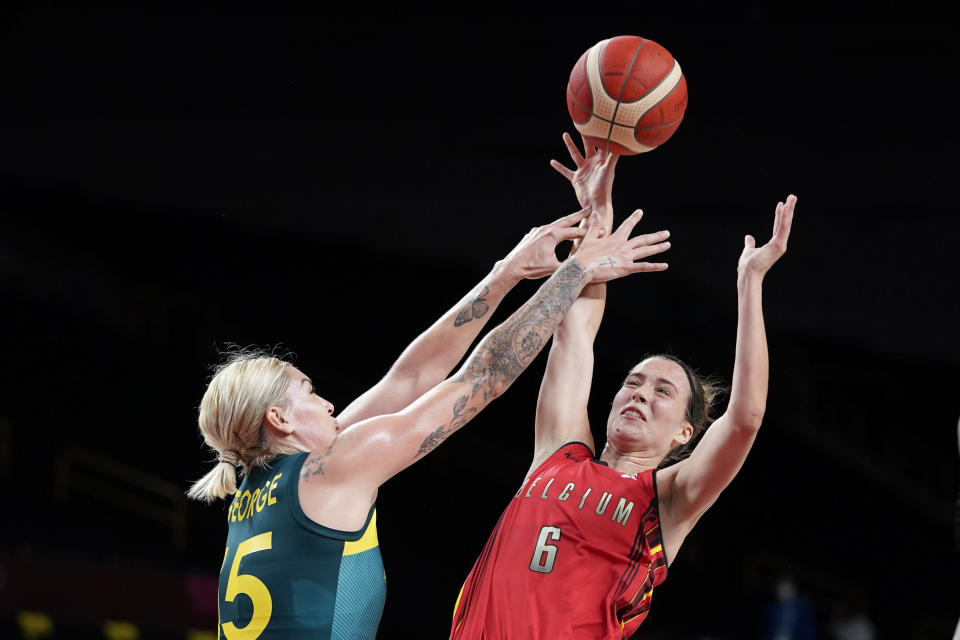 Belgium's Antonia Delaere (6) shoots over Australia's Cayla George, left, during a women's basketball preliminary round game at the 2020 Summer Olympics, Tuesday, July 27, 2021, in Saitama, Japan. (AP Photo/Charlie Neibergall)