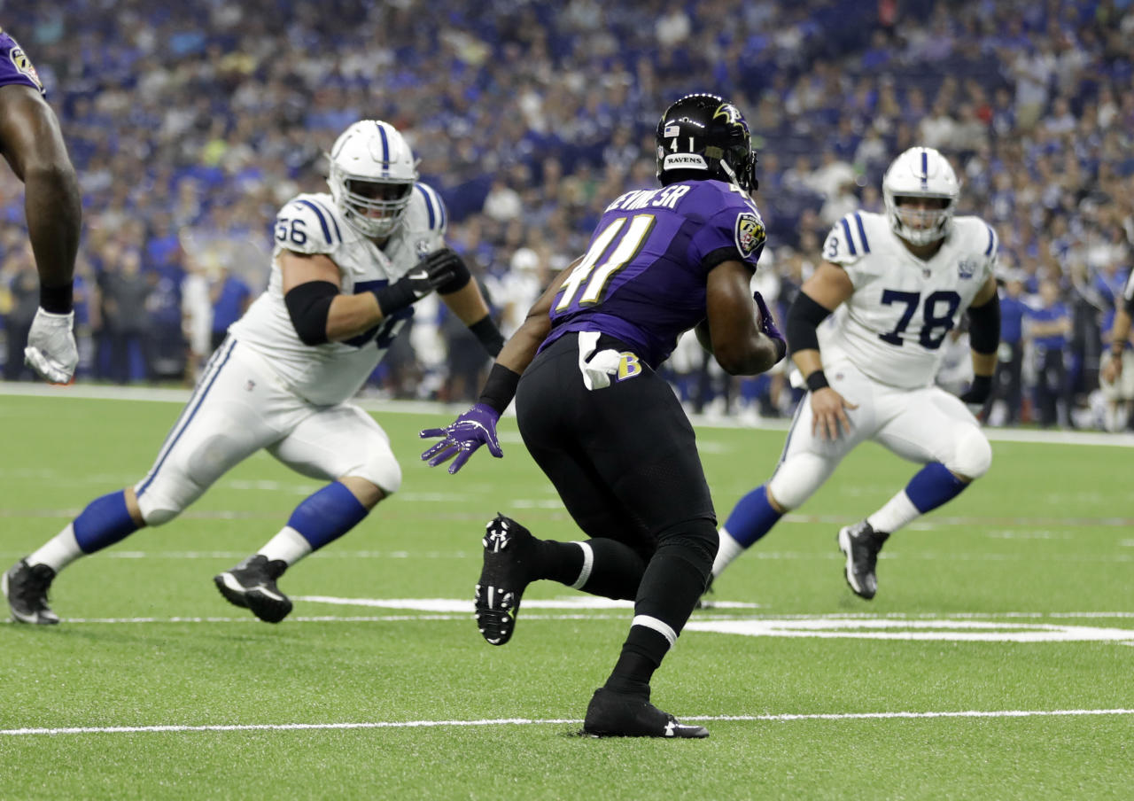 Baltimore Ravens defensive back Anthony Levine (41) returns an interception between Indianapolis Colts offensive guard Quenton Nelson (56) and center Ryan Kelly (78) in the first half of an NFL preseason football game in Indianapolis, Monday, Aug. 20, 2018. (AP Photo/Darron Cummings)