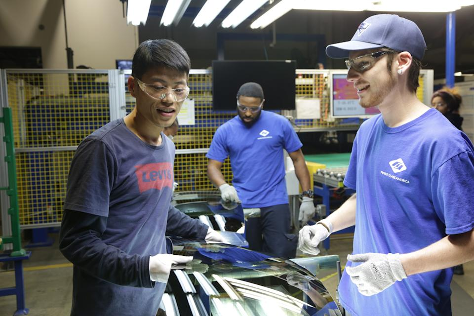 Wong He (left) working with Kenny Taylor (Center) and Jarred Gibson (Right) in the furnace tempering area of the Fuyao factory in the Dayton, Ohio from the film AMERICAN FACTORY