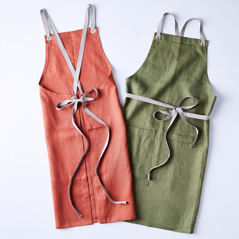 <p>These <span>Studiopatró Cross-Back Linen Kitchen Aprons</span> ($84 each) are great picks for spring.</p>