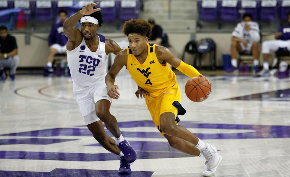 Feb 23, 2021; Fort Worth, Texas, USA; West Virginia Mountaineers guard Miles McBride (4) moves against TCU Horned Frogs guard RJ Nembhard (22) during the second half at Ed and Rae Schollmaier Arena. Mandatory Credit: Tim Heitman-USA TODAY Sports ORG XMIT: IMAGN-446552 ORIG FILE ID:  20210223_gav_sh2_108.jpg