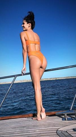 <p>She showed off her toned bod in a bright orange bikini while enjoying a day out on a boat.</p>