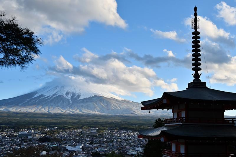 This picture taken on April 27, 2019 shows the Mount Fuji, the highest mountain in Japan, from the Chureito Pagoda in the Fujishoshida village, Yamanashi prefecture. (Photo by Charly TRIBALLEAU / AFP) (Photo credit should read CHARLY TRIBALLEAU/AFP via Getty Images)