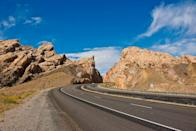 """<p>While the entirety of the national Interstate Highway System is a marvel, the intricacies of I-80 offer a glimpse at what makes the system so historic. <a href=""""https://www.interstate-guide.com/i-080/"""" rel=""""nofollow noopener"""" target=""""_blank"""" data-ylk=""""slk:Spanning 11 states in total"""" class=""""link rapid-noclick-resp"""">Spanning 11 states in total</a>, it starts with a crossing of the Bay Bridge in San Francisco, crosses the Bonneville Salt Flats near the Great Salt Lake, reaches 8,000 feet above sea level in Wyoming, and has a 72-mile stretch—the longest of all interstates—of virtually straight run outside of Lincoln, Nebraska. The freeway teases within a few miles of Chicago and Cleveland on its way to terminating four miles shy of New York City.</p>"""