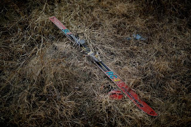 <p>A Fischer ski lies in grass at the abandoned Alps Ski Resort located near the demilitarized zone separating the two Koreas in Goseong, South Korea, Jan. 17, 2018. (Photo: Kim Hong-Ji/Reuters) </p>