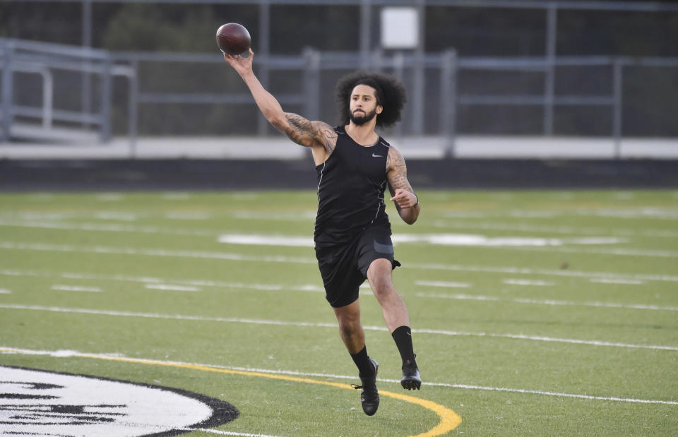 RIVERDALE, GA - NOVEMBER 16:  Former NFL quarterback Colin Kaepernick goes through a series of passing drills at Crescent Stadium at Charles R. Drew High School. (Photo by Austin McAfee/Icon Sportswire via Getty Images)
